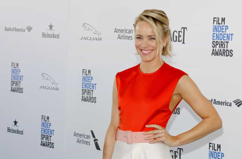 Here's how you can take your classic French twist to a new level — give it some long loose bangs. Style your hair in a French twist or a half updo, like Rachel McAdams. Then pull out some long strands of hair from the front and the side for a messy look.