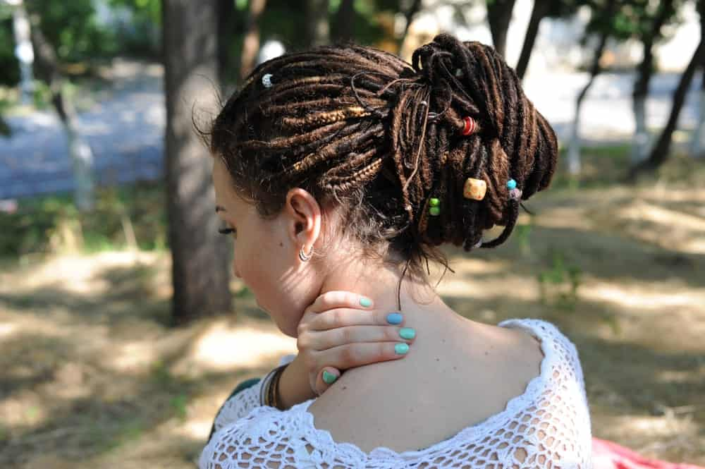 If you have dreadlocks, a great way to style them for prom is to bundle them up in a nice thick bun. It's going to make it look elegant and trendy while keeping your hair out of the way while you get down on the dance floor!