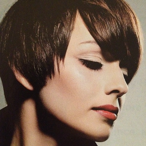 This stunning pixie cut has been achieved with choppy cuts, curling irons and lots of pomade. The haircut gives a very edgy and cool look and also emphasized the jawline.
