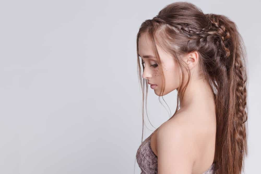 This beautiful hairstyle takes inspiration from bohemian hairdos with a few different combinations of braids that are twisted and pinned along the ponytail. The overall look is trendy and fun while still being pretty enough to turn heads.