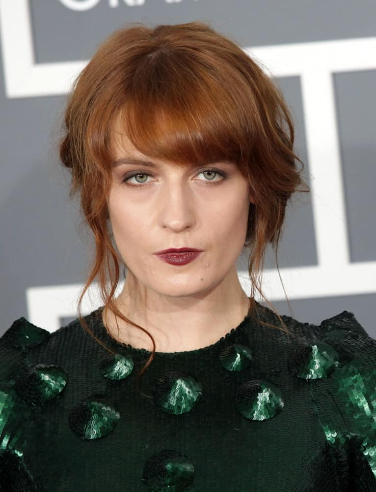 For a more dramatic effect, style your bangs wider like Florence does here. It gives the illusion of thicker hair and we love the finished look!