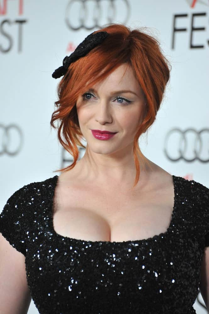 Recall that we mentioned pearly accessories go great with copper hair. Well so does black! Add a simple, chic headband like Christina Hendricks does here for a polished finish.