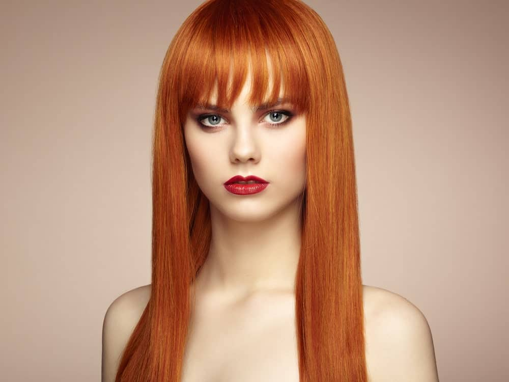 This look is great for those who have super-straight long hair but adventurous people can try it with their short hair as well. The eyebrow-touching bangs are cut in straight jags and then separated. The straight cut brings out more focus to the eyes and cheekbones.