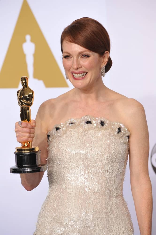 Julianne Moore keeps it sleek and classy for the Academy Awards with a side swept, neat bun. It's the perfect hairstyle for formal gatherings and never goes out of style!
