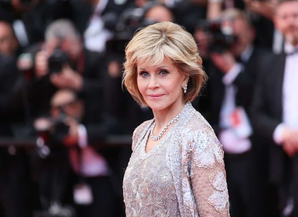 Jane Fonda has sported this super-cool vintage look since the 1960s. It still works for her. To give this look a bit of a modern update, go for a side part and sweep the hair gently to the side.