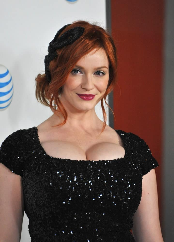 If you want a slightly more glamorous bun, you should take a leaf out of Christina Hendricks' book. She loosens up the bun and lets a few face framing strands hang in loose curls for a more laid back, stylish effect.