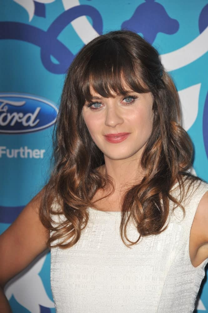"The ""New Girl"" actress is famous for her signature look, which features eye-skimming bangs and curly locks. Not only does this hairstyle give her a truly youthful look, it is very effortless and elegant as well, and perfect for all occasions."