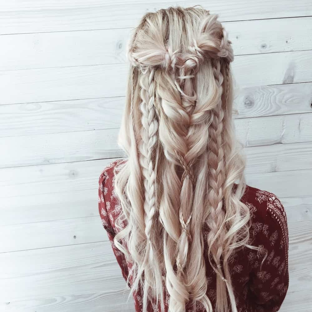 This boho inspired hairstyle involves intricate braids cascading down the back of your head with a combination of French, Dutch, and waterfall braids.