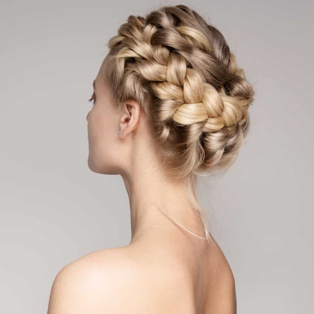 This beautiful braided updo is created by twisting your hair into a braid from one side and bringing it to the other side, forming a full crown of braid around the head. This lovely hairstyle will make you feel like a princess.