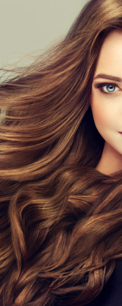 Woman with beautiful wavy brunette hair