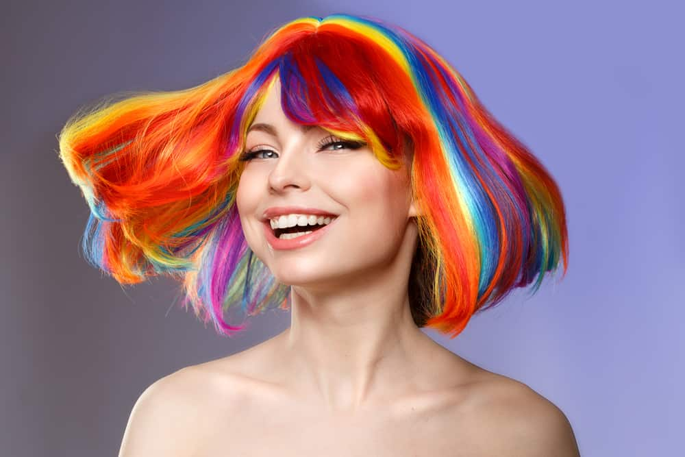 A model sporting rainbow colored hair in a bob
