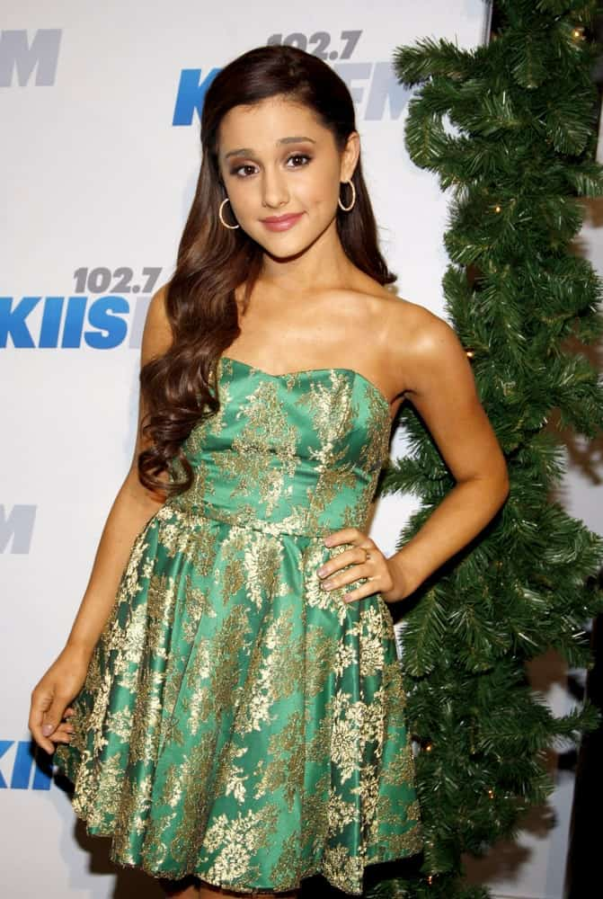 Ariana Grande looks charming in a green tube dress along with her chocolate brown waves that she wore during the 2012 KIIS FM's Jingle Ball on December 1, 2012.