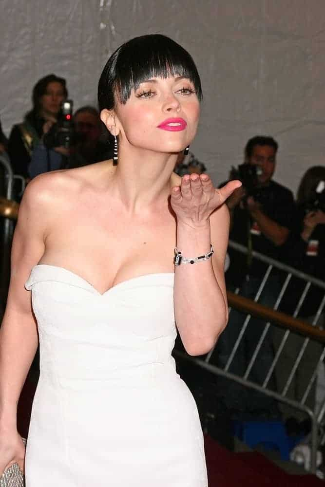 Christina Ricci was at the Metropolitan Museum of Art Costume Institute Gala - Poiret King of Fashion in New York, NY on May 07, 2007. She was charming in a white strapless dress and raven bun hairstyle that has blunt bangs.