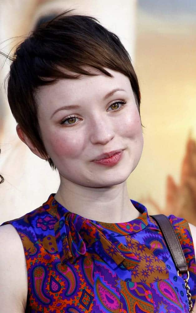 Emily Browning attended the Los Angeles premiere of 'Legends of the Guardians: The Owls of Ga'Hoole' held at the Grauman's Chinese Theater in Hollywood on September 19, 2010. She wore a lovely colorful dress to match her short pixie brunette hairstyle that has side-swept short bangs.