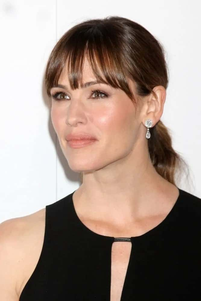 She pulled her brunette hair back into a chic low pony with wispy bangs at the 5th Annual Thirst Gala on June 24, 2014.
