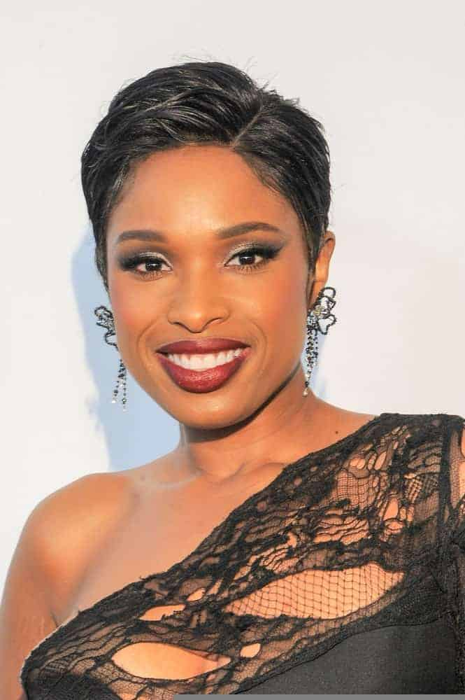 Singer Jennifer Hudson attended 'Clive Davis: The Soundtrack Of Our Lives' world premiere at Radio City Music Hall on April 19, 2017 in New York City. She was seen wearing a stunning black dress with her side-parted raven pixie hairstyle.