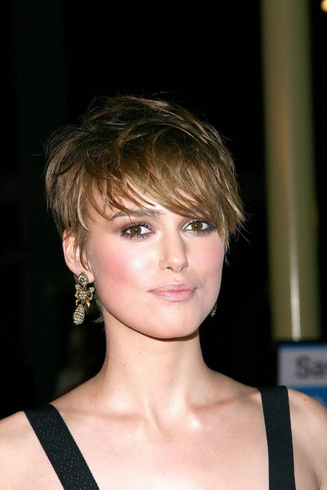 Keira Knightley was at The Jacket Premiere, Pacific ArcLight Theaters, New York, NY on February 28, 2005. She came in a simple black outfit to pair with her tousled and side-swept pixie hairstyle with highlights.