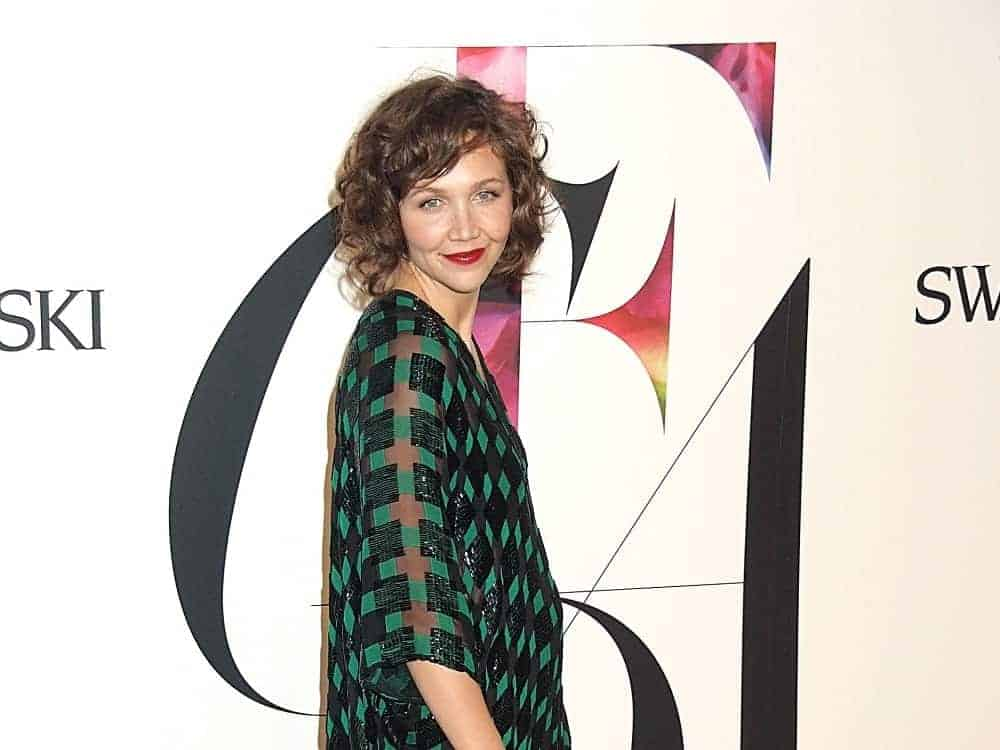 Maggie Gyllenhaal wore a Proenza Schouler dress at The 2008 CFDA Fashion Awards at The New York Public Library, New York on June 02, 2008. She paired this with a chin-length tousled brown curly hairstyle with side-swept bangs.