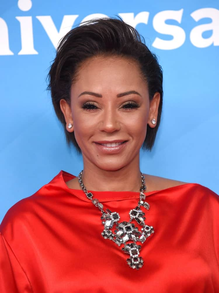 Mel B brushes up her dark pixie and paired it with a statement necklace at the 2018 NBC Universal Summer Press Day held on May 2, 2018.