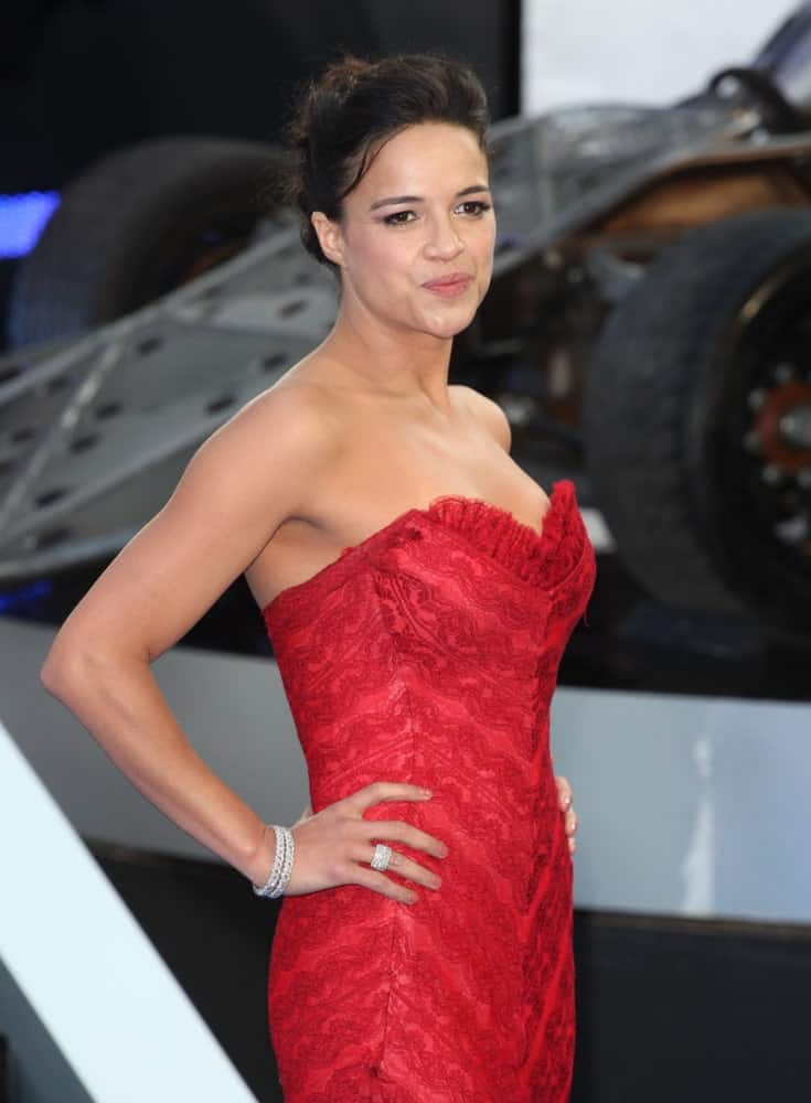 On July 5, 2013, Michelle Rodriguez attended the 'Fast And Furious 6' premiere in a red patterned dress that she paired with a glam updo.