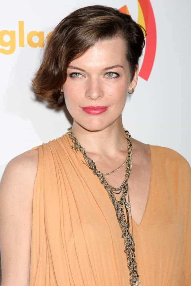 Milla Jovovich was at the 23rd GLAAD Media Awards at Westin Bonaventure Hotel on April 21, 2012, in Los Angeles, CA. She was charming in her simple beige dress, red lips, and chin-length brunette hairstyle that is side-swept.