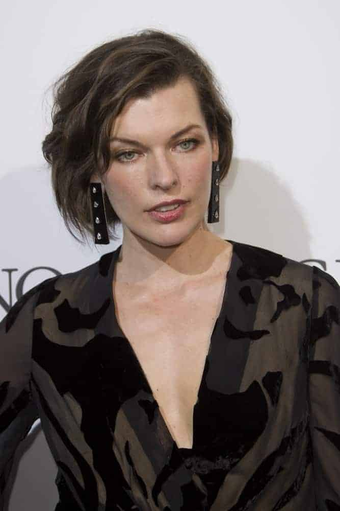 Milla Jovovich attended the De Grisogono Party at the annual 69th Cannes Film Festival at Hotel du Cap-Eden-Roc on May 17, 2016, in Cap d'Antibes, France. She wore a black patterned dress with her tousled chin-length hairstyle that has side-swept bangs.