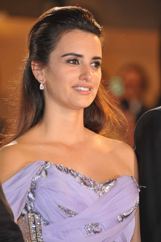Penelope Cruz gathered her long, straight hair into a half upstyle during the premiere of her new movie