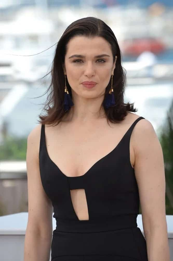 Rachel Weisz oozed in a black jumpsuit and left her straight above-the-shoulder haircut down with flippy ends as she attends the photocall for her movie