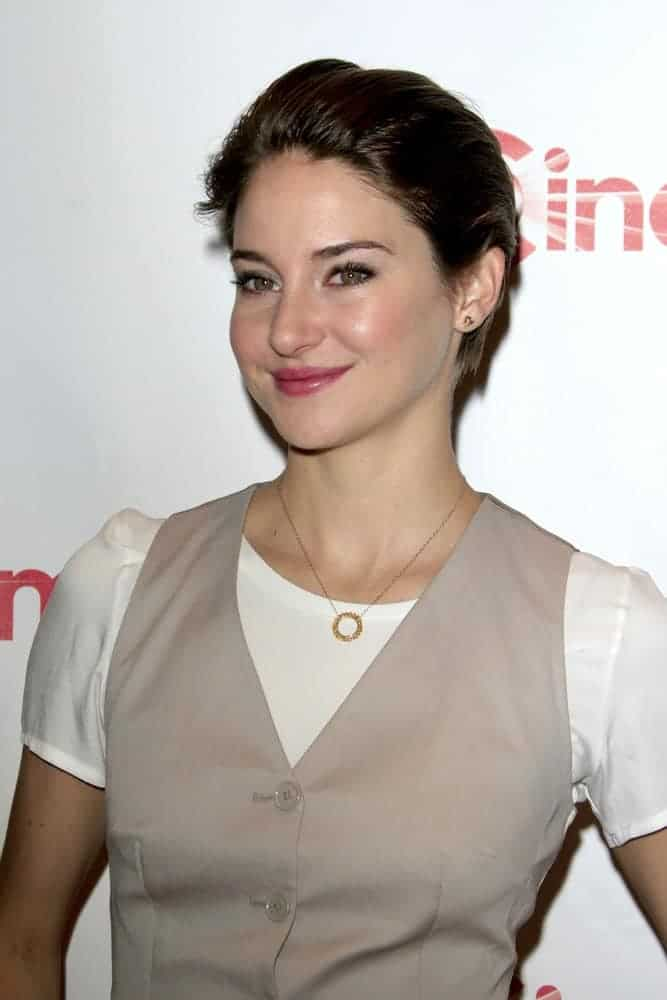 Shailene Woodley attended the 20th Century Fox CinemaCon 2014 Photo Call at Caesars Palace on March 27, 2014, in Las Vegas, NV. She wore a vest over her white blouse and paired it with a slicked-back raven pixie hairstyle.