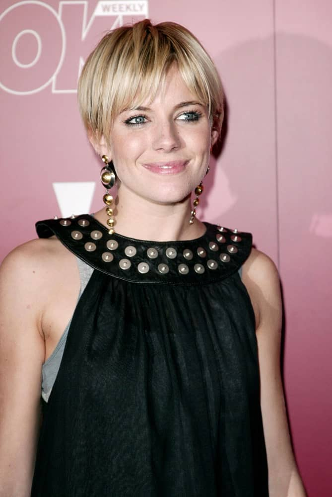 Sienna Miller looking all young and fresh in a blonde pixie with bangs at The Weinstein Company 2006 Pre-Oscar Party held on March 04, 2006.
