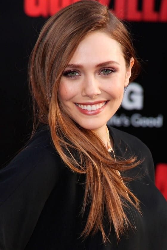 Elizabeth Olsen proves that with a few subtle highlights, all you need is to run a comb through your hair and you are ready to rock the beautiful long hairstyle.