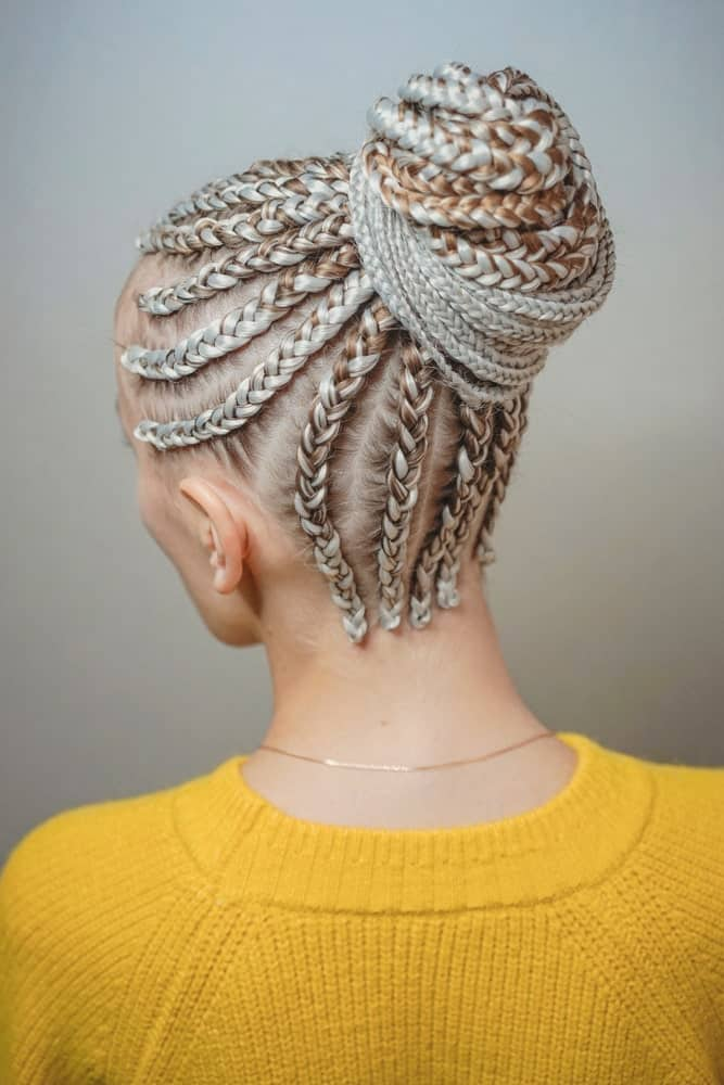 Once you have made box braids, you can either create a high box braid ponytail or a high bun; the choice is yours. If your hair is medium or shorter in length, then you can simply flaunt simple box braids without any further styling.