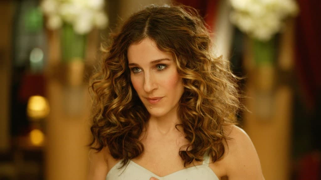 "Sarah Jessica Parker iconized the Carrie Bradshaw hairstyle in the comedy series ""Sex and the City."" The actress styled her dark gold layers into riotous curls that brought the perm back to the masses. The style is airy, effortless and can be worn at all sorts of events"