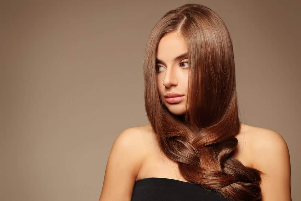 This is a mix of straight and wavy with half a middle parting and super straight hair till mid length, followed by slightly curled-wavy hair, giving it a gorgeous finish. This hairstyle is perfect for parties and evening dinners.