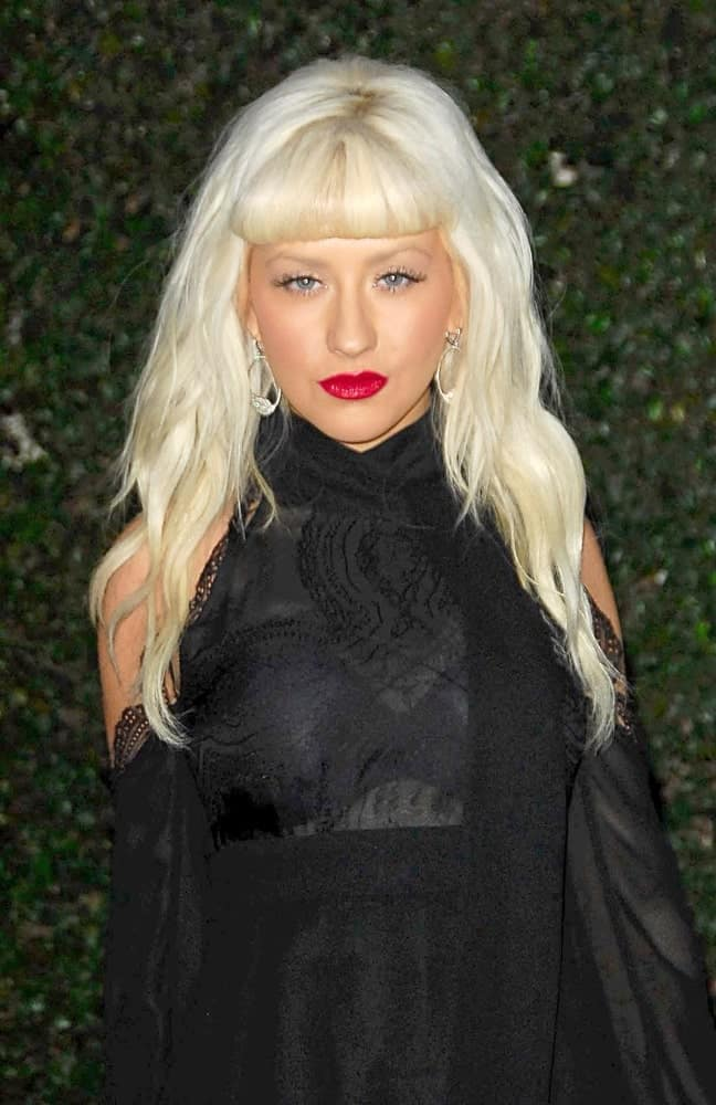 Christina Aguilera has supported many different short bangs hairstyles over the years. She has slightly puffed up short bangs which look completely separated from her other hair. It makes her forehead look smaller and makes her eyes look more intense.