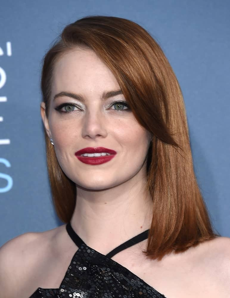 Take notes from Emma Stone on how to rock a simple hairstyle using straight hair. A shoulder-length cut combined with a side-part and side-swept bangs look impressive on all hair colors. However, you might need some bold lip color plus some glittery eyeshades to counterbalance the otherwise plain style.