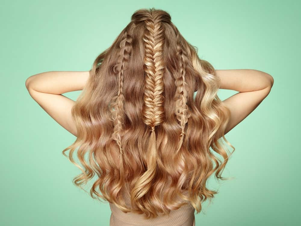 Thick, sandy locks mean lots of hair to play with. Try a mermaid hairstyle with a multitude of thin, straight, plain and fishtail braids and style your lose hair into natural waves. Rock the look at a party, a bar or a red carpet event.
