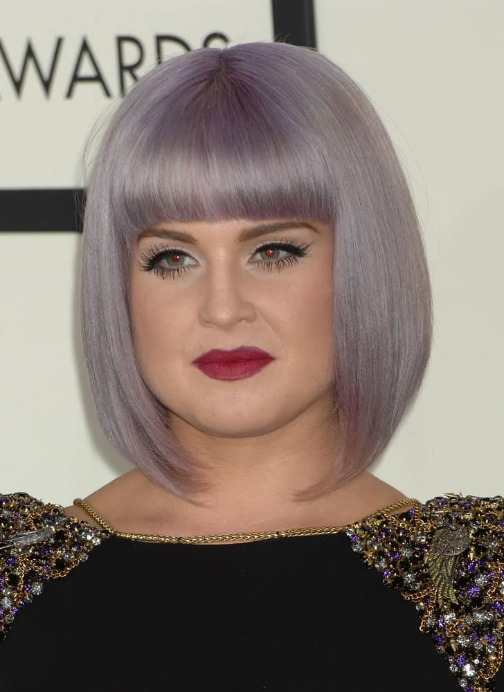 With her silver-purple hair color, blunt bangs, and sleek long-bob, Kelly Osbourne is on fire! With a long inward bob, this hairstyle perfectly frames the face to bring focus to the facial features, especially the eyes and lips. Depending on the length of the bangs, your eyebrows may or may not hide behind your hair.