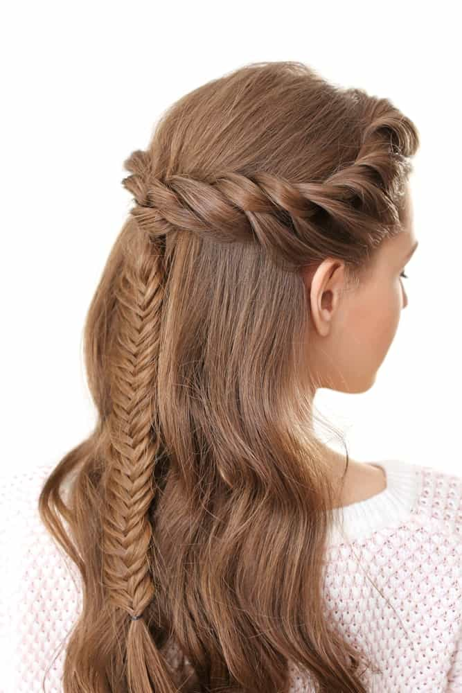 For a super pretty party or wedding hairstyle, try this beautiful crown braid hairstyle. Twist your hair from the front and then bring it to the side and then the back. Then weave the rest of the locks into a tight and intricate braid of your choice. You can either incorporate all your hair into the braid or leave half of it flowing down your back.