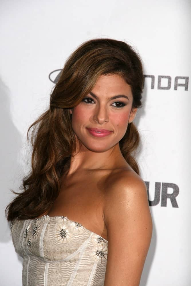 If you are a fan of bangs, this hairstyle is perfect for you. Modeled by Eva Mendes, this hairstyle for long brunette hair features long bangs set to one side while on the other side, the hair is slightly tucked to the back. The rest of the hair sprawls on one side, running done the shoulder to the back. This hairstyle can be your ultimate everyday look because it is not only easy to create, but it is also quite easy to keep your hair in place when they are styled like this.