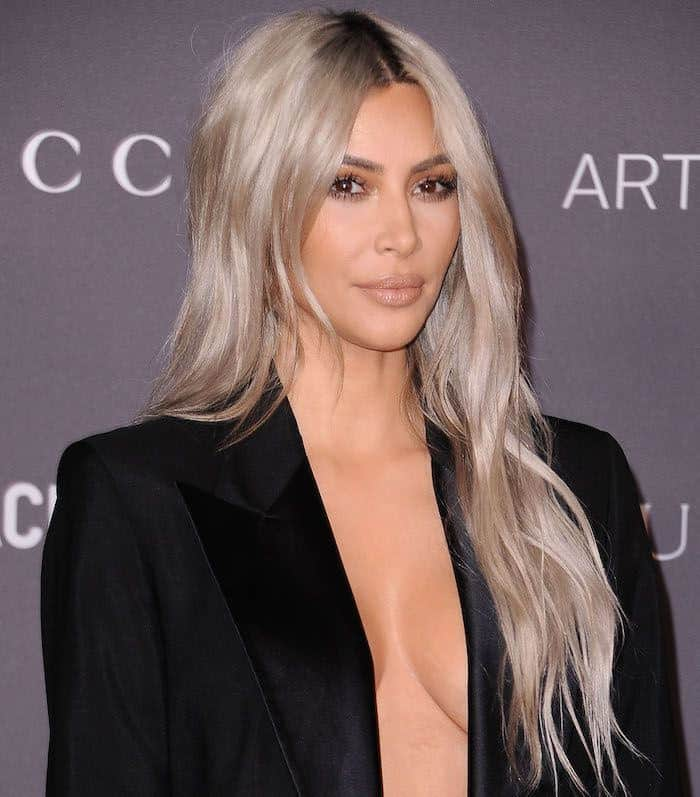 Kim Kardashian's hair has almost always been thick and long. The socialite loves to play with her hair, and this is one of her dramatic styles. The actress dyed her hair a shimmery, platinum silver — the color that is trending these days — and left the thick layers loose and breezy.