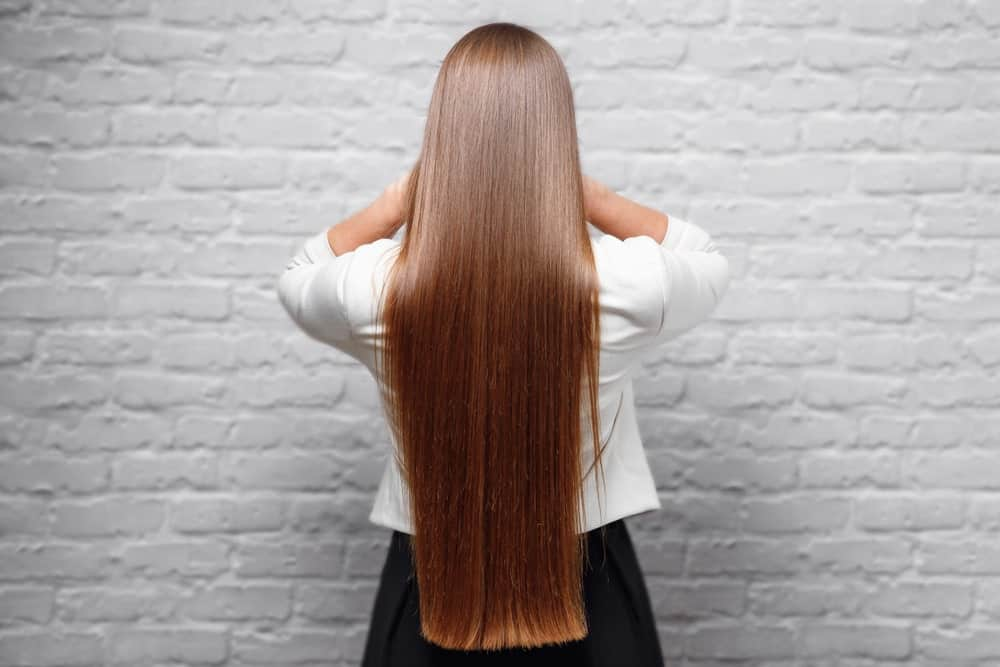 A beautiful statement balayage means you dont need to fuss with your hair that often. Ask your stylist to give your hair a beautiful, vivid color, like this chestnut-and-fox-red balayage. Just comb your long hair down your back and leave it flowing. It is perfect for all occasions.