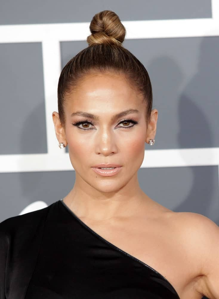 Check out this contemporary and stylish, sleek hairstyle sported by Jennifer Lopez. The hairstyle is relatively simple and ties all your hair at the top of your head in a tight bun. The end result is absolutely stunning