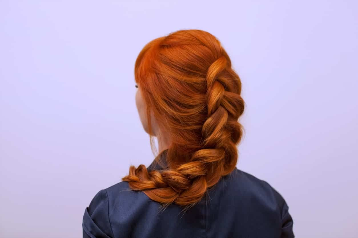 French braids look really pretty at any event. The auburn color also highlights the hairstyle even more since they won't stand out so well with darker hair colors.