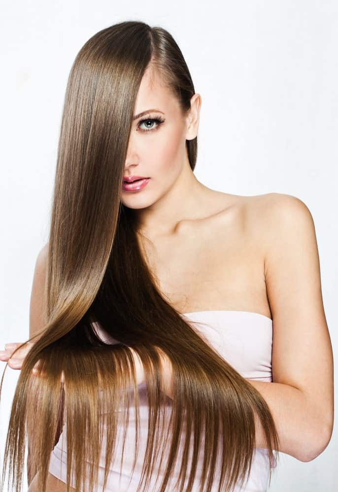 This has to be one of the most distinctive looking hairstyles out there in which all the hair has been pulled to one side with a side parting. Towards the end, the hair seems to have been parted in small sections, giving it a very clean, crisp texture.