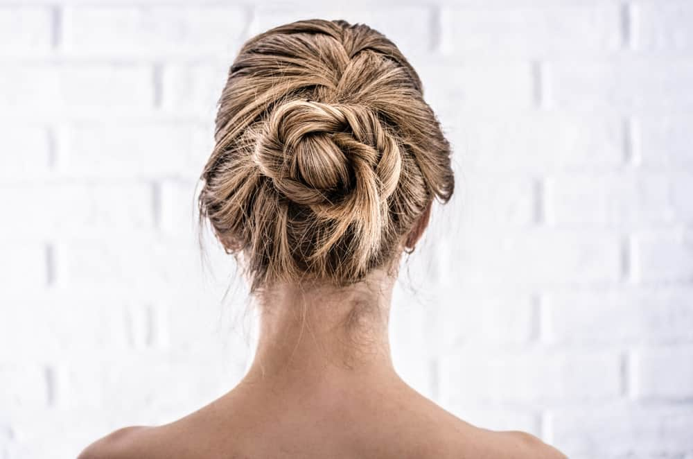 The perfect marriage between a braid and an updo, this knot looks quite complicated — but it is actually not. To get this look, start a French braid from the very top of your crown. Then twist the braid into a figure-8 knot and secure it with bob pins. A great wedding hairstyle is done in just a few minutes!