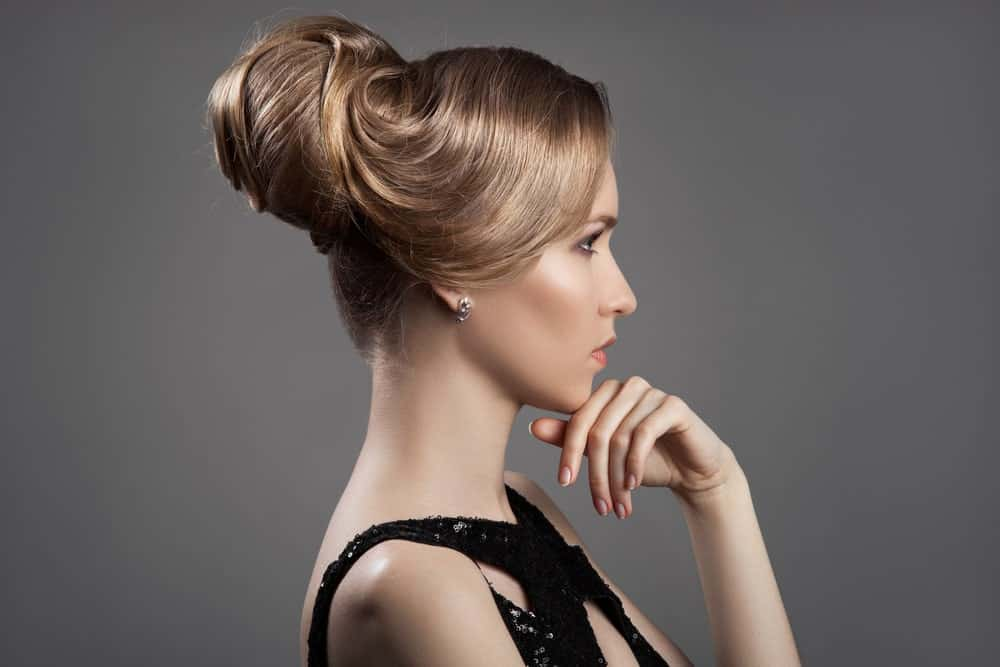 Do you want to get ready for a party or a wedding but don't know how to style your hair? If you have a long, glossy mane, here is a great style. Ask your stylist to pull your hair back in an elegant updo that curls in on itself and ends with a pseudo beehive, like they used to wear in the '60s. The antique brown hair color will also enhance the period look.