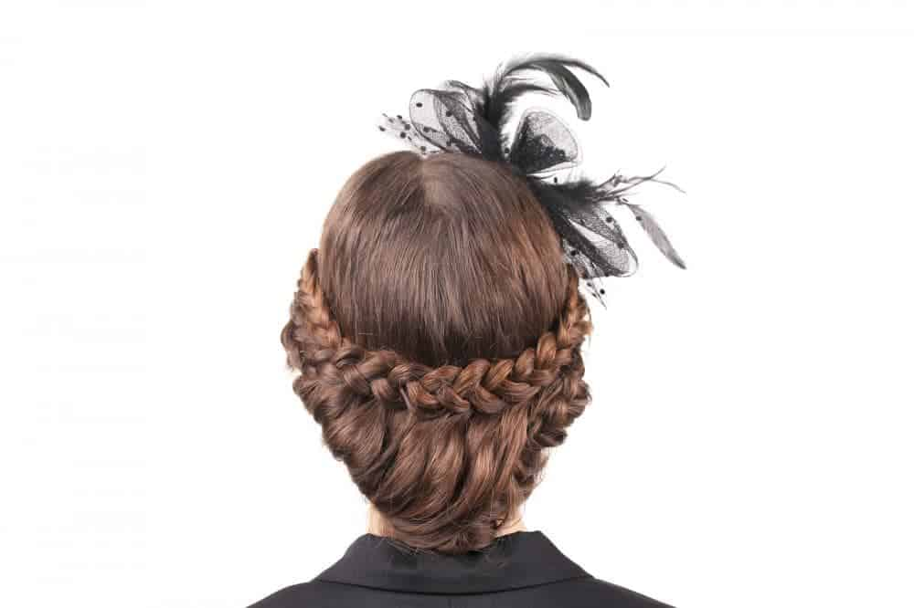 This festive hairstyle features an across-the-back braid that runs from ear to ear. The remaining hair is tucked under for a sensational style.