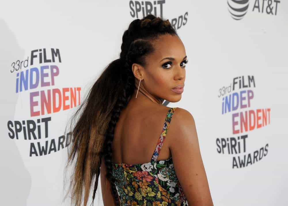 Kerry Washington is not afraid to rock her hair, whether natural or styled. Here, the actress has made a compromise with both by styling the top part of her hair into dreadlocks while leaving the bottom with frosted, spiky layers.