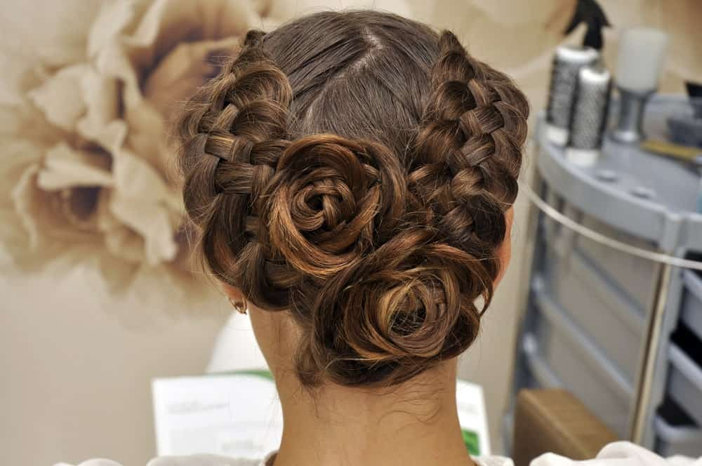 Who wouldn't love some lovely roses? This hairstyle for long brunette hair can take your love for flowers to the next level. It is perfect for weddings or prom-nights. The hairstyle features two thick braids which start in the front and end in a formation at the back that looks like roses! If you are looking for a way to add an X-factor to your look for your special event, opt for this hairstyle!